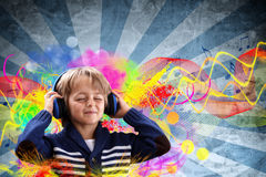 Boy listening to music. Young boy with headphones listening to music with colorful funky grunge retro background Stock Photo