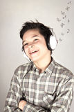 Boy listening to pop music. Smilling boy listening to pop music Royalty Free Stock Images