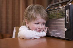 Boy Listening To Retro Radio Stock Photo