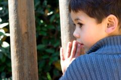 Boy listening to wooden music stock image