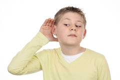 Boy listens Stock Photography