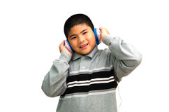 Boy listens attentively to the music. Stock Image