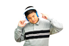 Boy listens attentively to the music. Royalty Free Stock Image