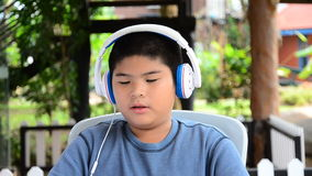 A boy listens music. HD stock video footage