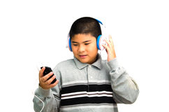 Boy listens the music. Stock Images