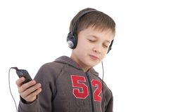 The boy listens to music Stock Image