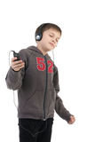 The boy listens to music Stock Photo