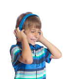 The boy listens to music on headphones. Stock Photos