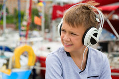 Boy listens to music on headphones Stock Image