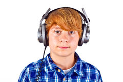 Boy listens to music with his headphones Stock Image