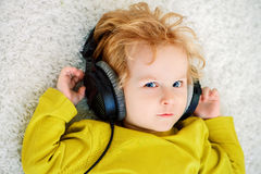 Boy listens to music stock photo