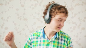 The Boy Listens to Music stock footage