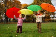 Boy and little girl in autumn park. Stock Photo