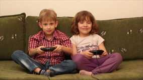 Boy and little girl play video game stock video