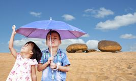 Boy and little girl in summer outdoor Stock Images