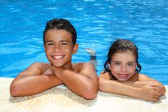 Boy and little girl summer vacation in pool Royalty Free Stock Photos