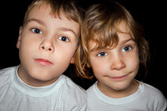 Boy and little girl in white T-shirts isolated Stock Images