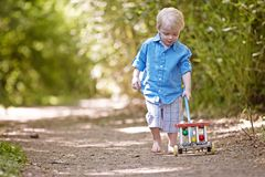 Boy. Little boy outside toy park playing cute happy sweet Stock Photo