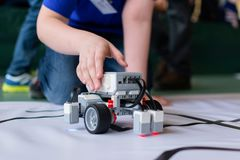 The boy and the little robot. City competitions of search robots among children royalty free stock photography