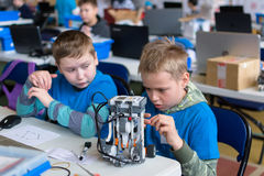 The boy and the little robot. Yoshkar-Ola, Russia - February 12, 2017 City competitions of search robots among children Stock Photo