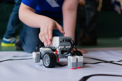 The boy and the little robot. Yoshkar-Ola, Russia - February 12, 2017 City competitions of search robots among children Stock Images