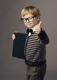 Boy little smart child in glasses showing blank card certificate. School education advertisement Stock Photos