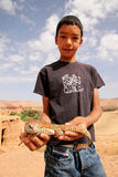 Boy with a lizard Stock Photo