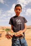 Boy with a lizard Stock Photo