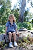 Boy on log. Little boy sitiing on log in Regional Park in SC Stock Photo
