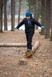 A boy on a log Stock Photos