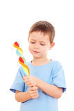 Boy with lollipop. 6-7 years old boy with lollipop on white - kids stock images