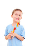 Boy with lollipop Stock Images