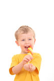 Boy with lollipop. 4-5 years old boy with lollipop on white - kids royalty free stock images