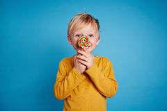 Boy with lollipop Stock Photo