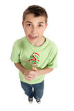 Boy with lollipop licking lips Stock Photos
