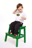 The boy with lollipop on light background Royalty Free Stock Images