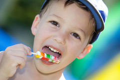 Boy with lollipop Stock Photo