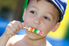Boy with lollipop Stock Photos