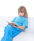 Boy with Long Blond Hair Playing with Digital Tablet Stock Photo