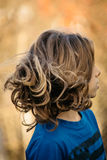 Boy with long hair Stock Photo