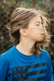 Boy with long hair. Teen boy with beautiful long hair Royalty Free Stock Images