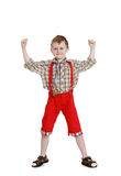 Boy in a long red shorts Royalty Free Stock Image