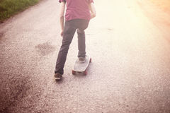 Boy on a longboard. Royalty Free Stock Photo