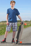 Boy with longboard Royalty Free Stock Photography
