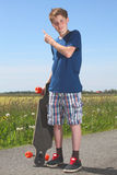 Boy with longboard Stock Photography