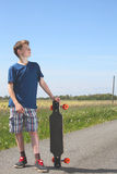 Boy with longboard Stock Photos