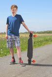 Boy with longboard Royalty Free Stock Image