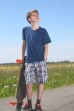 Boy with longboard Royalty Free Stock Photo