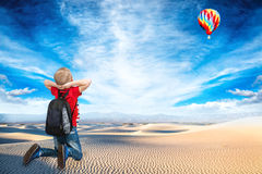 Boy look at the flight of the balloon on the background of beautiful nature. Travel.Boy look at the flight of the balloon royalty free stock image