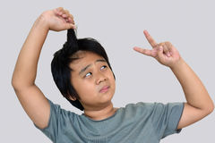 Boy look at long hair with gray background Royalty Free Stock Photography